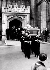 The coffin is carried from the Cathedral before being placed on the gun-carriage. Dame Mary Hughes followed.