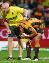 Alex Glenn of the Broncos leaves the field with a fractured eye socket.
