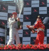 David Coulthard and Heinz-Harald Frentzen spray champagne on the podium at the 1998 Australian Grand Prix.