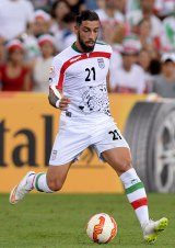 Centre stage: Ashkan Dejagah is the pivot in most of what Iran do well.