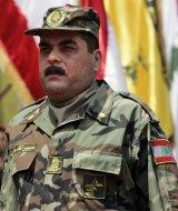 Samir Kuntar at the grave of slain top Hezbollah military commander Imad Mughniyah in 2008.