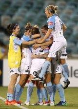 Melbourne City celebrate their semi-final win against Canberra United.