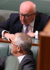 Attorney-General Senator George Brandis with Prime Minister Malcolm Turnbull in Parliament on Monday.
