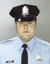 Hailed as a hero ... Philadelphia Police Officer Jesse Hartnett fought back despite being shot three times.