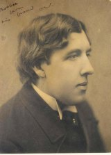An undated image of Oscar Wilde with his inscription to his companion Robert (Bobbie) Ross.