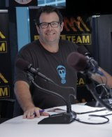Gus Worland in his day job as a host on Triple M's Grill Team breakfast show.