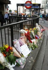 Floral tributes line the pavement outside Monument underground station in the London Bridge area.