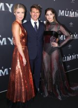Cruise, Wallis, left, and Boutella on the black carpet in Sydney.