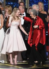 Elisabeth Moss and author Margaret Atwood embrace as The Handmaid's Tale wins the Emmy for outstanding drama series.