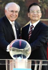June 2006: John Howard and then Chinese premier Wen Jiabao press a launch button to mark the beginning of deliveries of liquid natural gas to China's Guangdong province.