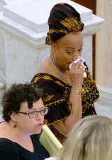 One of Bill Cosby's accusers reacts at the Montgomery County Courthouse after the mistrial was declared.