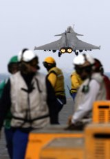 A French Navy Rafale fighter jet takes off from the aircraft carrier Charles de Gaulle on Monday, February 23, 2015.