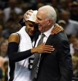 Winners: Gregg Popovich and Patty Mills embrace.