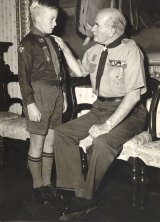 Sir William Slim, Chief Scout of the Commonwealth, presents Wolf Cub David Turnbull, 10, with the Silver Cross for Gallantry for rescuing two boys from drowning in the Murray 1958.