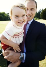 Prince George plays with his father, Prince William, in a 2015 photograph released to mark his second birthday.