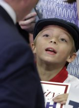Working the crowd: a young boy looks up at Donald Trump during a campaign stop in Knoxville, Tennessee.