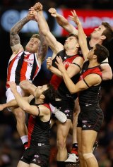 Higher and higher: Michael Hartley (centre) flies for a ball last weekend.
