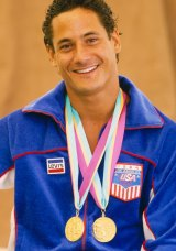 Greg Louganis poses with his two gold medals during the 1984 Summer Olympics.