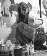 Charlotte Clemens painting a mural on a Lyon Street house, circa 1976.