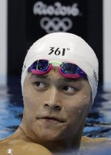 China's Sun Yang rests after bombing out in the men's 1500m freestyle heat on Friday.