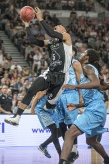 Stephen Holt launches himself towards the basket
