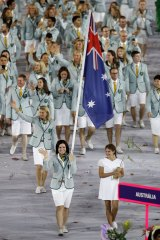 Anna Meares of Australia carries her country's flag during the Opening Ceremony of the Rio 2016 Olympic Games.