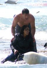 A Greek soldier  rescues Eritrean refugee Wegasi Nebiat from the sea off the Greek island of Rhodes in April.