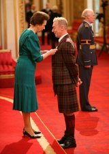 Receiving an OBE from Princess Anne in 2009.