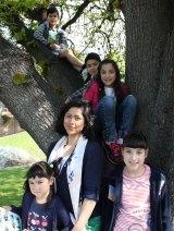 Katherine Santibanez with her children, clockwise from top, Judah, Declan, Ariel, Zara and Ruby.