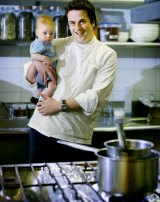 Chef, Darren Simpson with his son Angus, 2 months, in the kitchen of Aqua Luna in 2003.