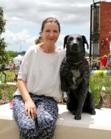 Brisbane sculptor Kathy McLay poses with her lifesize bronze statue of Sarbi, the former Australian Special Forces explosives detection dog at the opening of Sarbi Park at Warner Lakes.