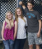 The Thorpe children (from left) Evan, Andie and Hamish, who look after their mother, Fred.