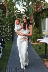 Jessica Gomes had the honour of carrying the best little man, Zion, the pair's chubby cheeked son, down the aisle.