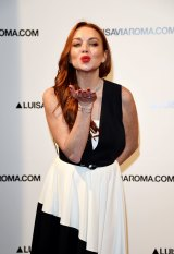 Lindsay Lohan walks the red carpet of Firenze4ever 14th Edition Party on January 9, 2017 in Florence, Italy.