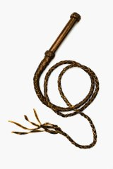 A brown leather whip reminded me of the life my childhood had picked for me.