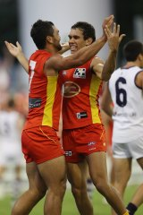Harley Bennell with former Suns player Karmichael Hunt in 2012.