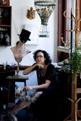 Animal lover: Julia deVille in her studio with her (real) dog Scout.