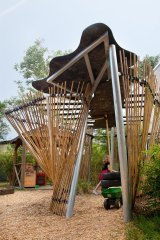 The Swinburne cubby translates the sketchiness of a child's line into bamboo poles strapped by bicycle tubes to a steel frame.