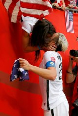 Abby Wambach celebrating Team USA's World Cup win with wife Sarah Huffman in 2015.