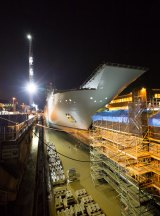 HMAS Adelaide enters the dry dock for examination.