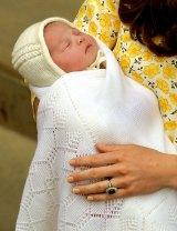 Catherine, Duchess of Cambridge holds her newborn daughter.