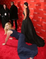 Comedienne Amy Schumer falls in front of Kim Kardashian and Kanye West at the 2015 Time 100 Gala in April.