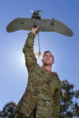 Australian Army soldier Corporal Doug Coombs prepares to launch a Wasp AE drone.