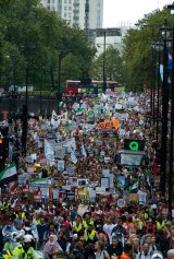 Demonstrators march through Westminster in London, calling on Prime Minister David Cameron to accept more refugees.