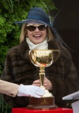 Gai Waterhouse with the 18-carat Melbourne Cup.