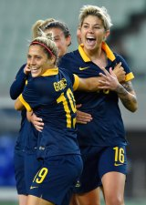 Living the dream: Michelle Heyman, right, celebrates scoring the first goal against North Korea.