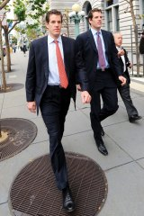 Cameron Winklevoss, left, and his twin Tyler leave a federal appeals court in San Francisco, California, US, in Janyary 2011. Facebook's settlement of claims that its founder Mark Zuckerberg stole the idea for what became the world's largest social-networking website should be undone, the former college classmates of Mr Zuckerberg told an appeals court.