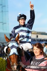 One to go: James McDonald celebrates his million-dollar triumph on Shooting to Win in the Caulfield Guineas.  He could record win number 1000 in the Caulfield Cup.