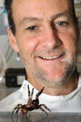 Biochemist Glenn King with a funnel web spider.