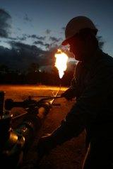 Coal seam gas field flaring near Chinchilla in Queensland.